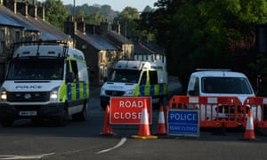 Police vehicles block the road near Toddbrook reservoir