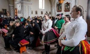 Women in traditional folk dress at Christmas mass last week