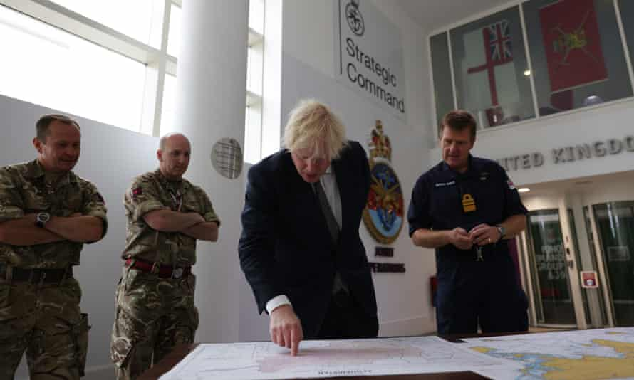 Boris Johnson with V Adm Ben Key as he looks at a map of Afghanistan during a visit to Northwood headquarters