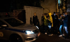 The Swedish ambassador to Belarus, Christina Johannesson (centre) arrives at a police station in Minsk to collect photographer Paul Hansen after his release