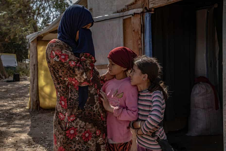 Mariam, 49, with her daughters
