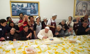 Mmmmm … Pope Francis cuts a cake during his lunch at a soup kitchen in Florence.