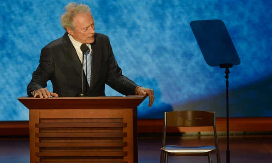 Clint Eastwood address a chair that he pretends has President Obama in it at the 2012 Republican National Convention.
