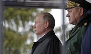 Vladimir Putin, left, at an event commemorating paratroopers killed in the second Chechen war