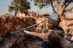 A young miner digs for cobalt in the Democratic Republic of Congo