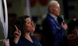 A sign language interpreter is seen as Joe Biden speaks during a campaign event in Gilford, New Hampshire, February 10, 2020.