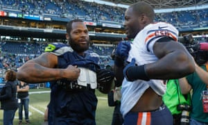 Michael Bennett (left) greets his brother, Martellus, during his time with the Bears