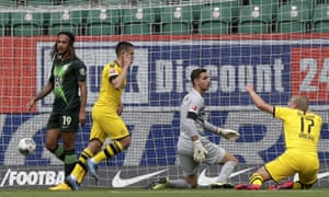 Dortmund's Raphael Guerreiro, 2nd left, celebrates after scoring the opening goal past Wolfsburg's goalkeeper Koen Casteels.