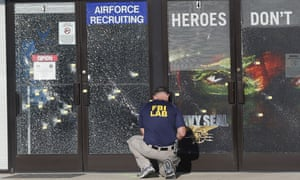 An FBI investigator investigates the scene of the shooting outside a military recruiting centre in Chattanooga, Tennessee.
