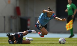 Caitlin Foord is tackled by Samantha Johnson at Lakeside Stadium on Sunday.