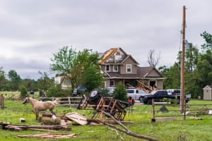Homes are severely damaged after a tornado struck the night before 29 May 2019 in Linwood, Kansas