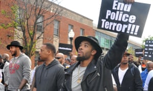 NBA star Carmelo Anthony, left, Baltimore protest
