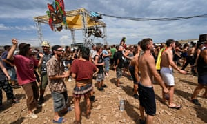 Up to 10,000 people dance and attend a rave party, on an agricultural land in Causse Mejean, in the heart of the Cevennes National Park, southern France on August 10, 2020, despite the limitation of gatherings linked to COVID-19, the novel coronavirus. Photo: Pascal Guyot / AFP