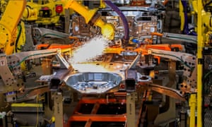 Sparks fly as robots spot weld vehicle chassis at the Ford plant in Chicago.