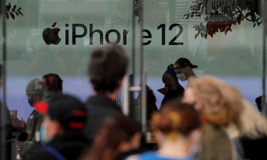 Customers wait in line outside an Apple Store to pick up the new 5G iPhone 12 in Brooklyn, New York on 23 October 2020.