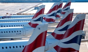 A line of British Airways planes at London City Airport.