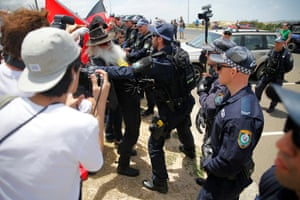A vocal Indigenous elder confronted police and was swiftly hauled towards a police van.