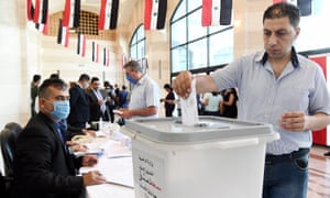 A voter casts his ballot during the parliamentary elections in Damascus, capital of Syria, on July 19, 2020. The parliamentary elections in Syria kicked off on Sunday, the third elections during the more than nine-year-long war, amid the participation of President Bashar al-Assad and his wife Asma. Credit: Photo by Xinhua/REX/Shutterstock