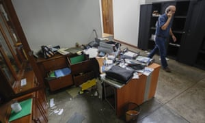 Carlos Fernando Chamorro, walks through the ransacked offices of Confidencial, which was raided by police in December