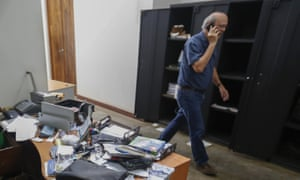 Carlos Fernando Chamorro walks through his ransacked offices