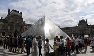 People queue at the Louvre museum hoping to see the Mona Lisa.