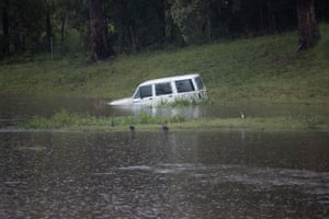 A car submerged in flood water