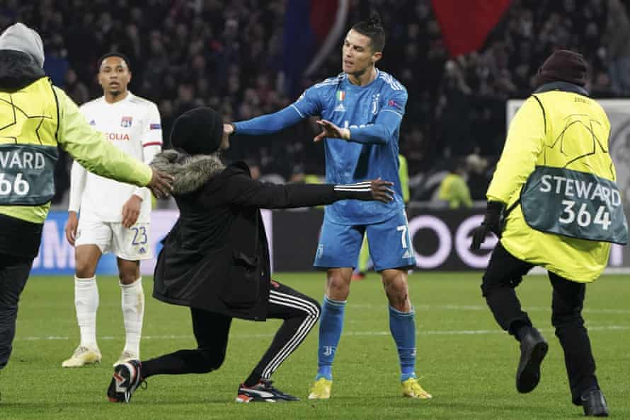 Fan kneels in front of Cristiano Ronaldo during Juventus match in Lyon in February 2020
