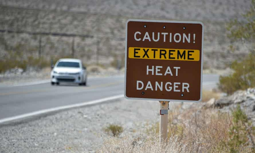 A posted sign warns motorists of extreme heat dangers in Death Valley National Park, in Furnace Creek, California.