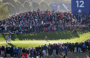 Europe's Ian Poulter lines up a putt.