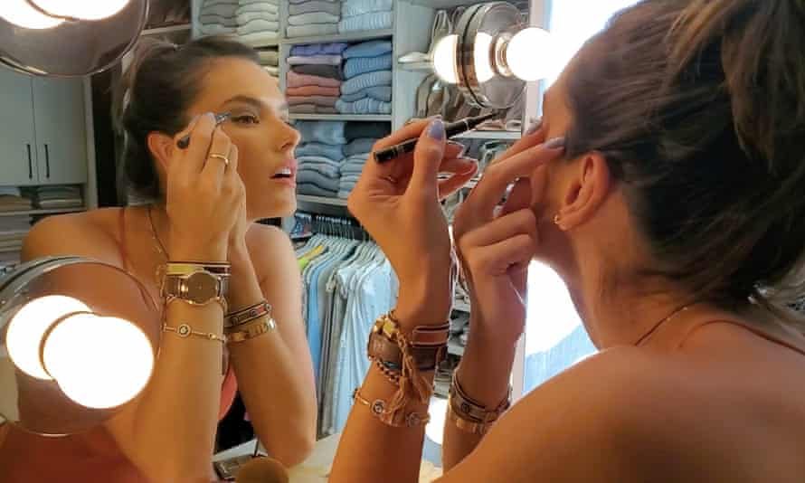 Alessandra Ambrósio makes up for her CR Runway slot, following video directions for 'smokey black eyes' from the event's make-up coordinator Tom Pecheux