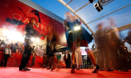 Guests arriving at a Cannes film festival premiere.