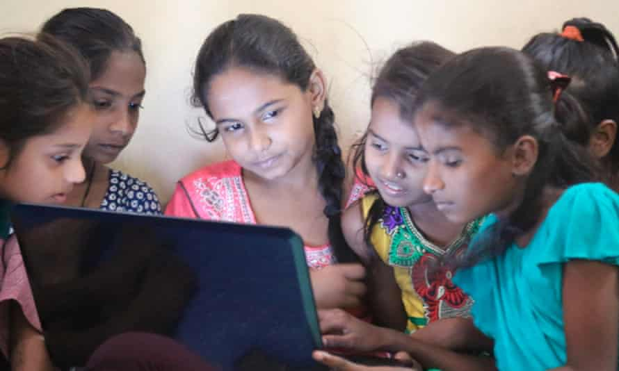 Girls learning use of computers at the Dharavi Diary school in Mahim, Mumbai.