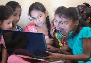 Girls learn how to use computers at a Dharavi Diary slum school in Mahim, Mumbai.