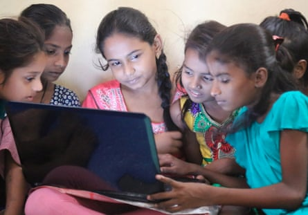 Girls learn how to use computers at a Dharavi Diary slum school in Mahim, Mumbai.