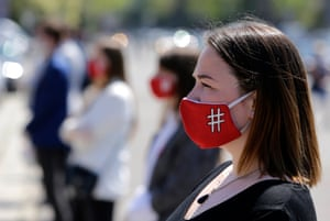 Belgrade, Serbia Members of the #1in5million anti-government movement wear masks with symbolic hashtags at a demonstration against government's handling of the pandemic