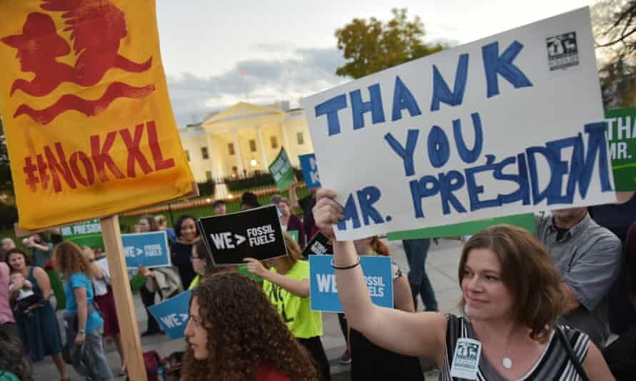Activists in front of the White House celebrate President Obama's blocking of the Keystone XL oil pipeline on Friday.