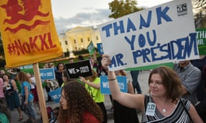 Activists celebrating Obama's blocking of the Keystone XL oil pipeline in front of the White House in November.