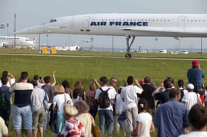 Fans watch the last flight of an Air France Concorde, at Charles de Gaulle airport in Roissy, France, in 2003