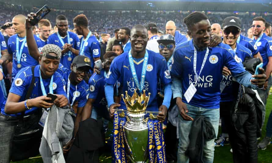 N'Golo Kanté celebrates with the Premier League trophy and his family after helping Leicester win the title in his only season at the club.