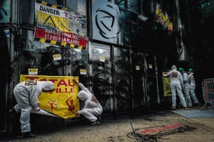 Paris, France: activists from the Association for the Taxation of Financial Transactions and for Citizens' Action (Attac) put up signs and spray windows of the headquarters of French oil company Total in La Defense