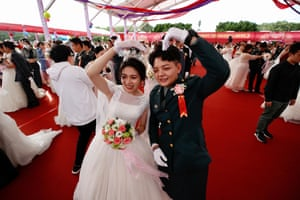 Taoyuan, Taiwan Ying-Hsuan Chen, right, and Li-Chen Li pose for a photograph during a military mass wedding. Two same sex couples tied the knot, the first time that same sex couples got married as part of a mass wedding held by the military since Taiwan became the first country in Asia to legalize same-sex marriage in May 2019