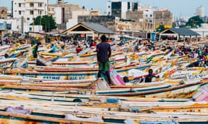 Boats crowd the waterfront at Soumbedioune market.