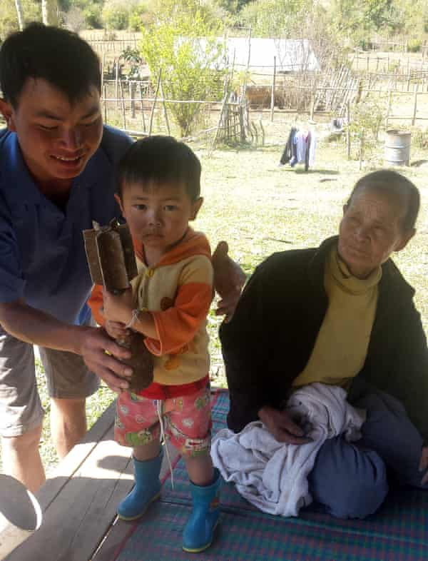 La lok with his mother Pheng See, 66, and his son Moveng, two, at their home in Ban Napia.
