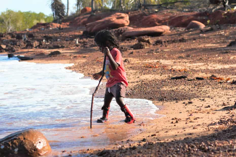 NDIS participant Gabriel, 3, plays on the beach on Elcho Island.