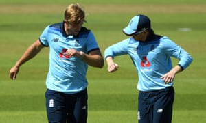 England's David Willey celebrates with his captain Eoin Morgan after taking the wicket of Ireland's Gareth Delany.