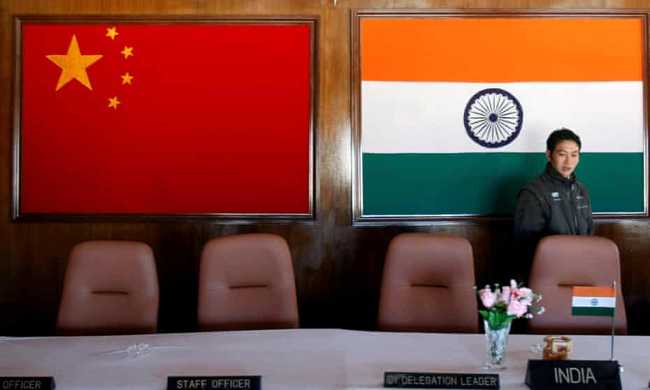 The flags of China and India are displayed at a conference room used for meetings between military commanders on the Indo-China border.