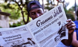 A Cuban reading the Communist Party paper the day after Fidel Castro died in Havana.