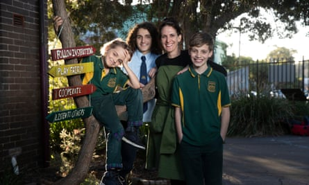 Proudly public: Lisa Barbagallo with her sons,15,11 and 8, at a public school in the inner west of Sydney.