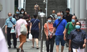 People wearing face masks are seen at a subway station in Singapore.