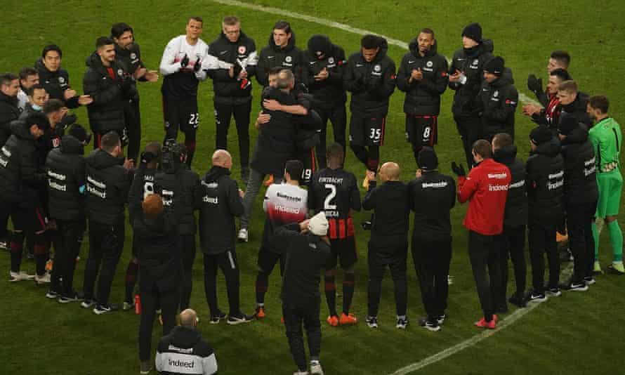 The Eintracht Frankfurt head coach Adi Hütter embraces the departing captain David Abraham in a post-match huddle following a 3-1 win against Schalke.
